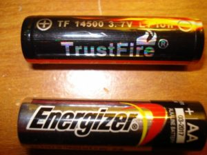 AA battery next to a 14500 lithium battery