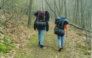 1280px-Hikers_with_packs