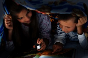 Children reading at night