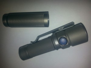 Olight S15 shown with its extender