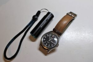 Imalent LD10 next to a standard wrist watch
